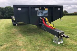 Bale trailer with option for swivel or spoon hitch
