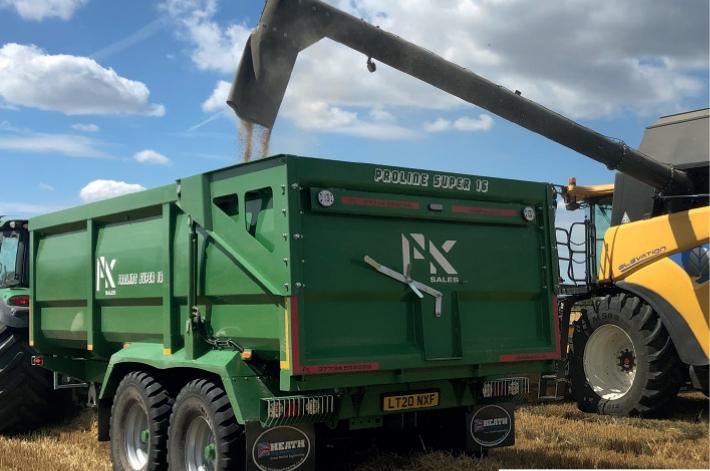 PK Poline grain trailer in use.
